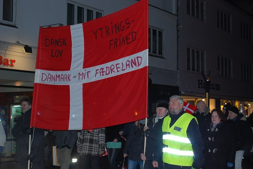 The second demonstration in the row of demonstrations took place in Esbjerg. Here the Danish flag in front. On the flag it says Danish Law, Freedom of Speech,  Denmark - my country.